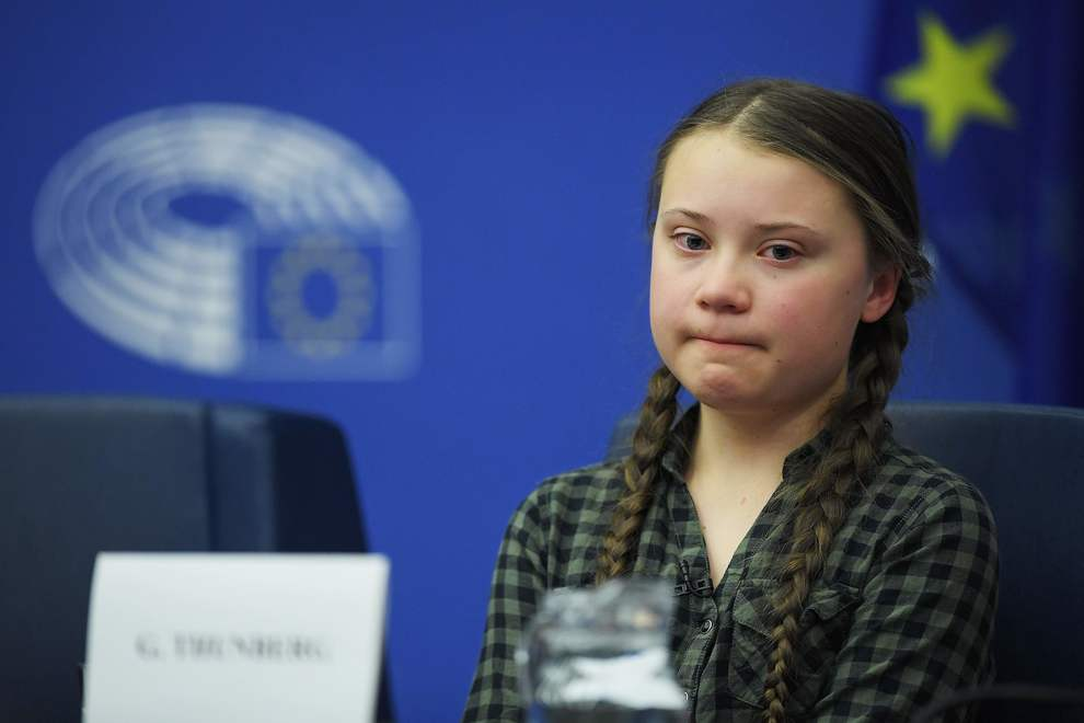 Swedish climate activist Greta Thunberg looks on during a debate with the EU Environment, Public Health and Food Safety Committee during a session at the European Parliament on April 16, 2019 in Strasbourg, eastern France. - Sweden's teenage activist Greta Thunberg on April 16 urged Europeans to vote in next month's elections on behalf of young people like her who cannot yet cast ballots but demand decisive action against climate change. During a visit to the European Parliament in the French city of Strasbourg, Thunberg, 16, told a press conference that time is running out to stop the ravages of global warming. (Photo by FREDERICK FLORIN / AFP)
